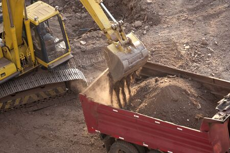 Excavator loading a truck on a construction site Stock Photo - 8860899