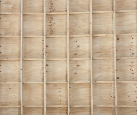 partitions: Wooden shelf with partitions in a squared pattern Stock Photo