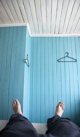 Relaxing in a hostel room - simple wooden walls