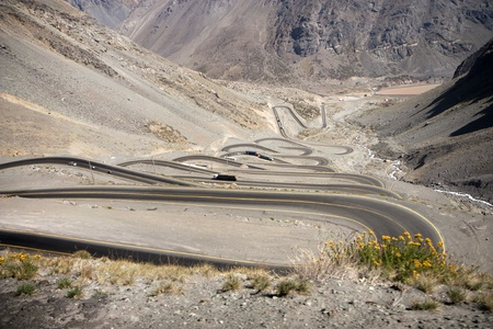 Curvy road between Chile and Argentina - crossing the Andes Stock Photo