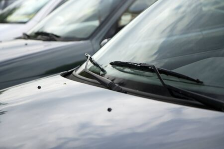 scrapers: Wipers and cars at a car park
