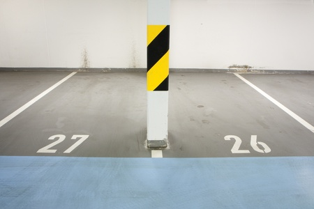 Underground garage - parking lot in a basement of house Stock Photo