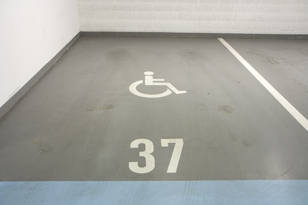 disabled person: Underground garage - parking lot in a basement of house for disabled person Stock Photo