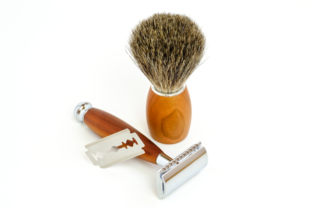 Traditional steel razor with hairy shaving brush isolated in white