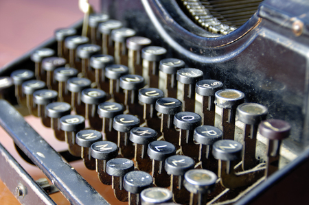 qwerty: vintage keys of old typewriter macro, details, obsolete writing machine Stock Photo