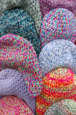 The handmade wool caps in variegated colors