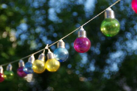 vitreous: Colorful vitreous bulbs. Lamps on wire. Stock Photo