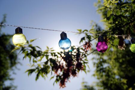 Colorful vitreous bulbs. Lamps on wire. Imagens