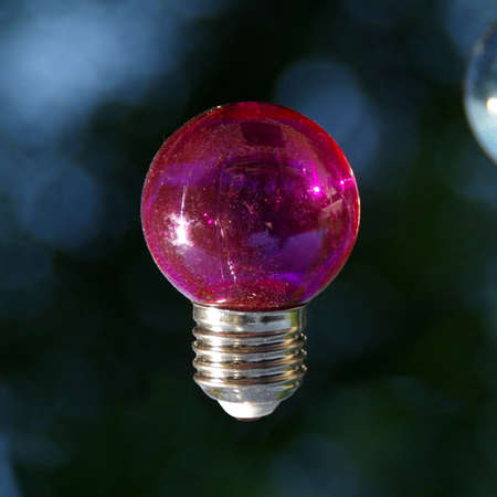 Red vitreous bulb on dark background Imagens
