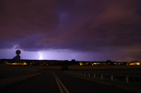 Lightning on heavy and dark clouds. Storm sky.