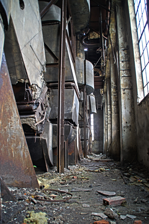 The interior of an old ruined factory. Forgotten foundry furnace.