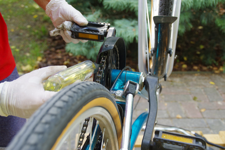 Bicycle maintenance and oiling by repairman. Bike mechanical service. 스톡 콘텐츠