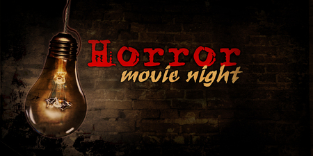 Horror movie night with large bulb and brick wall in background illustration