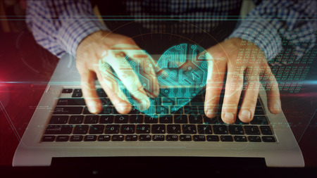 Man typing on laptop keyboard with heart on hologram screen. Cyber dating, love, romantic, rendez-vous, health and medical online care concept. Futuristic technology.