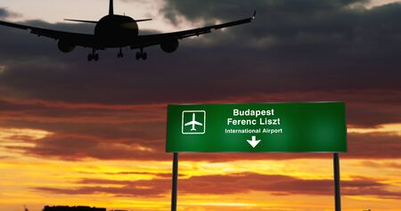 Airplane silhouette landing in Budapest, Ferenc Liszt, Hungary. City arrival with airport direction signboard and sunset in background. Trip and transportation concept 3d illustration.