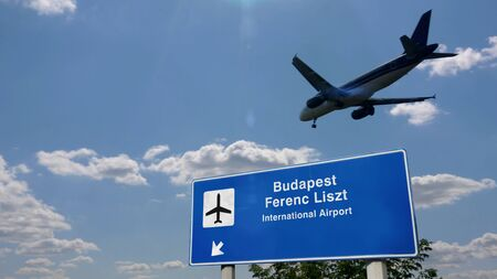Airplane silhouette landing in Budapest, Ferenc Liszt, Hungary. City arrival with international airport direction signboard and blue sky in background. Travel, trip and transport concept 3d illustration.