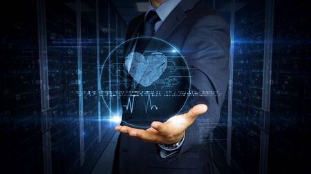 Businessman in a suit touch the screen with cybernetic heart symbol hologram. Man using hand on virtual display. Love, cyber dating, romantic, health and cardiology futuristic concept.
