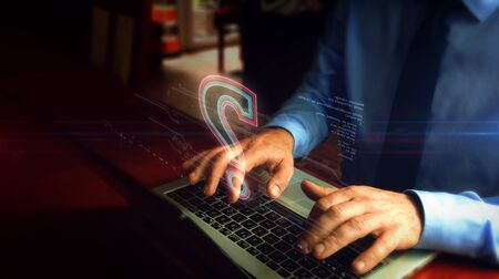 Man typing on laptop with question mark heart hologram screen over keyboard. Knowledge, faq, information searching and education concept. Natural hand camera shake.