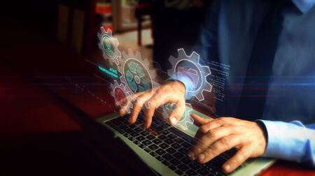 Man typing on laptop with data management hologram screen over keyboard. Files storage, cyber security, computer using and digital protection technology concept. Hand camera shake.