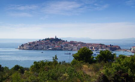 Primosten, Croatia, 19 august 2019 panorama view with boats on sea. Old mediterranean travel destination and vacation in sunny day. Stock Photo