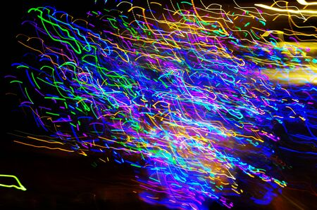 Abstract lights lines. Hundreds moving color points on dark background.