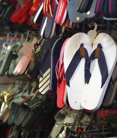 Shop hanger with flip-flops. Seasonal tourist shop. 写真素材