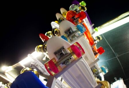 Skateboards on hanger in shop. Perspective view of skating boards stack. 写真素材