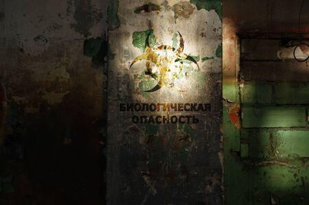 Biohazard warning on old damaged wall. Destroyed and forgotten building after disaster. Biology danger symbol alert. Stock fotó