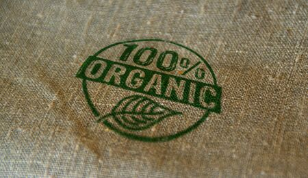 Organic 100 percent stamp printed on linen sack. Ecology, bio, gmo free, natural and healthy diet concept. Stockfoto