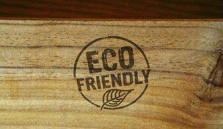 Eco friendly stamp printed on wooden box. Ecology, organic, natural, life style and healthy diet concept. Stockfoto