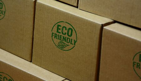 Eco friendly stamp printed on cardboard box. Ecology, organic, natural, life style and healthy diet concept.