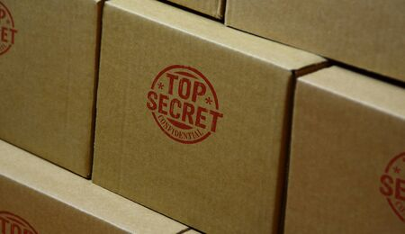 Top secret confidential stamp printed on cardboard box. Government, business, legal and non public document  concept.