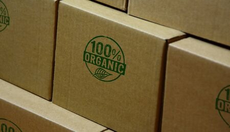 Organic 100 percent stamp printed on cardboard box. Ecology, bio, gmo free, natural and healthy diet concept.