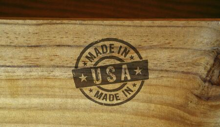 Made in USA stamp printed on wooden box. Factory, manufacturing and production country concept. Stockfoto
