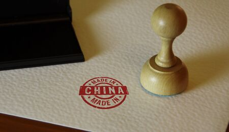 Made in China stamp on paper. Factory, manufacturing and production country concept.