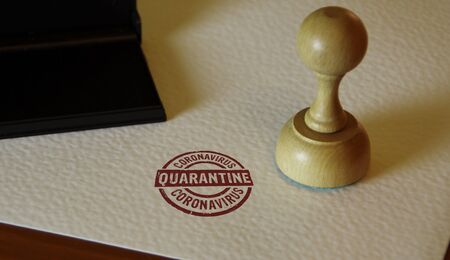 Quarantine stamp and stamping hand. Covid-19 virus protection, coronavirus isolation and health safety concept.