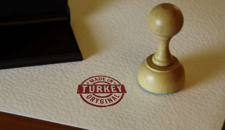 Made in Turkey stamp and stamping hand. Factory, manufacturing and production country concept.