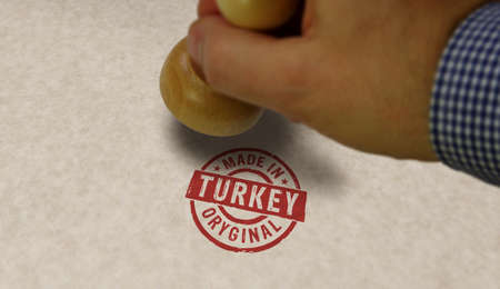 Made in Turkey stamp and stamping hand. Factory, manufacturing and production country concept. Reklamní fotografie - 154368955