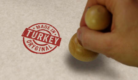 Made in Turkey stamp and stamping hand. Factory, manufacturing and production country concept. Reklamní fotografie - 154368959
