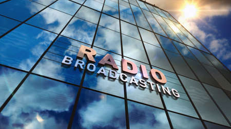 Radio broadcast sign on glass building. Broadcasting station, on air, news media and telecommunication concept in 3D rendering illustration. Mirrored sky and city on modern facade. Reklamní fotografie - 154812082