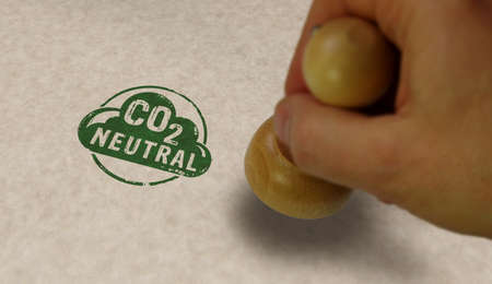 CO2 carbon neutral emission stamp and stamping hand. Ecology, nature friendly, climate change, green fuel and earth protect concept. Reklamní fotografie