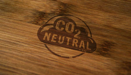 CO2 carbon neutral emission stamp printed on wooden box. Ecology, nature friendly, climate change, green fuel and earth protect concept.