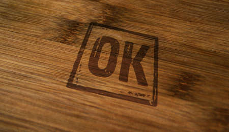 OK approved stamp printed on wooden box. Document accepted, admitted and success concept.