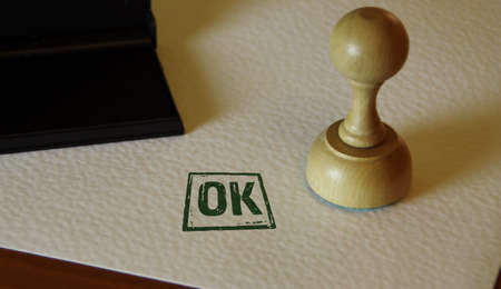 OK approved stamp and stamping hand. Check, accepted, admitted and success concept.