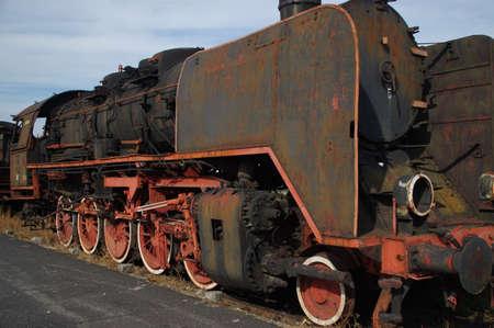Steam locomotive. Old rusty railway machine. Retro coal industry. 写真素材