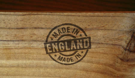 Made in England stamp printed on wooden box. Factory, manufacturing and production country concept.