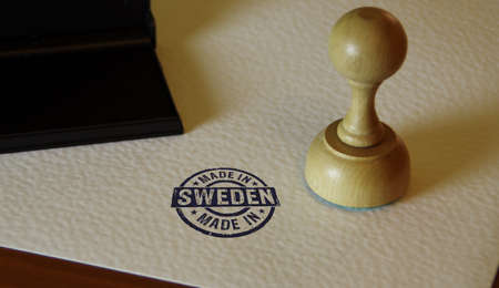 Made in Sweden stamp and stamping hand. Factory, manufacturing and production country concept.