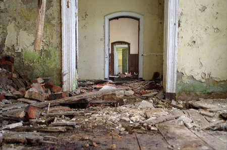 Old abandoned house interior. Ruins of the building with damaged floor.