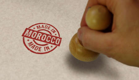 Made in Morocco stamp and stamping hand. Factory, manufacturing and production country concept.