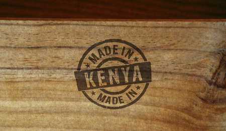 Made in Kenya stamp printed on wooden box. Factory, manufacturing and production country concept.